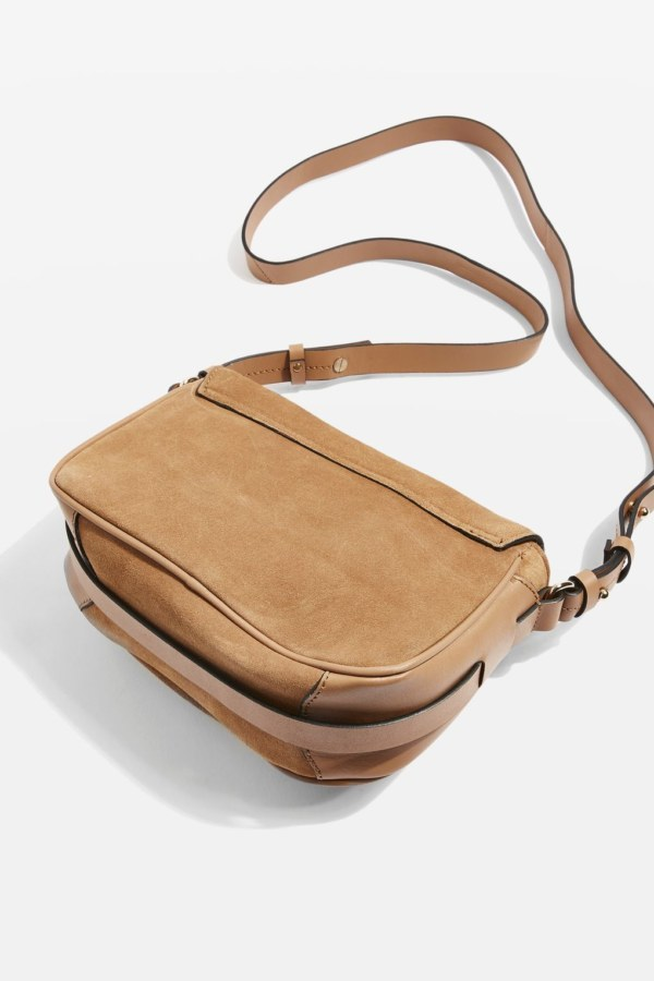 Back side of tan cross body bag